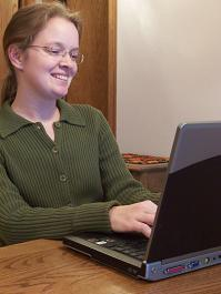Professional woman working at laptop